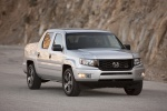 2013 Honda Ridgeline in Alabaster Silver Metallic - Driving Front Right View